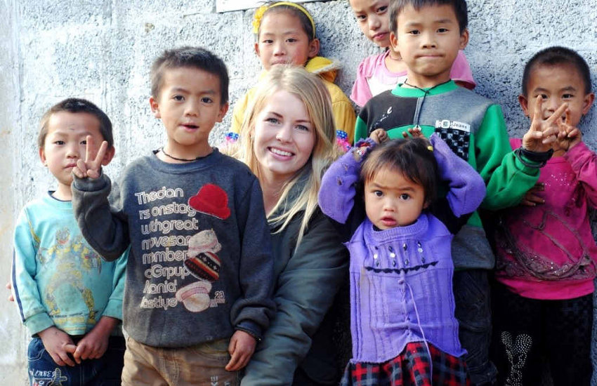 Marthe taking photos with kids in China