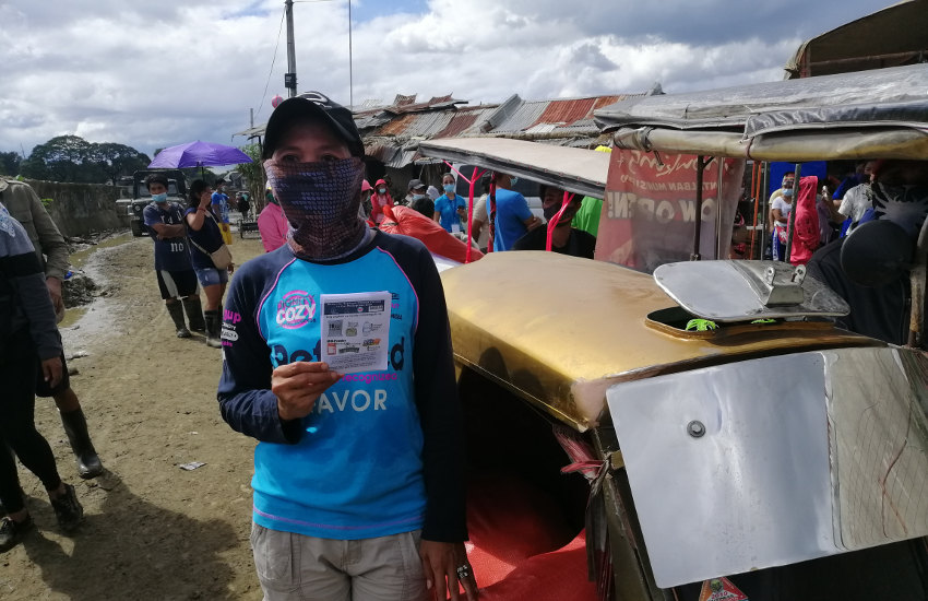 Local partners distributing relief goods for typhoon Vamco in the Philippines