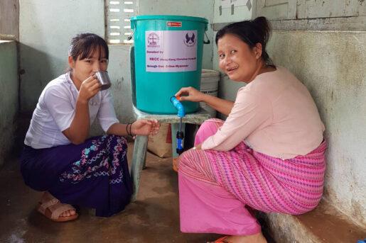 Women in Myanmar enjowing fresh and clean water