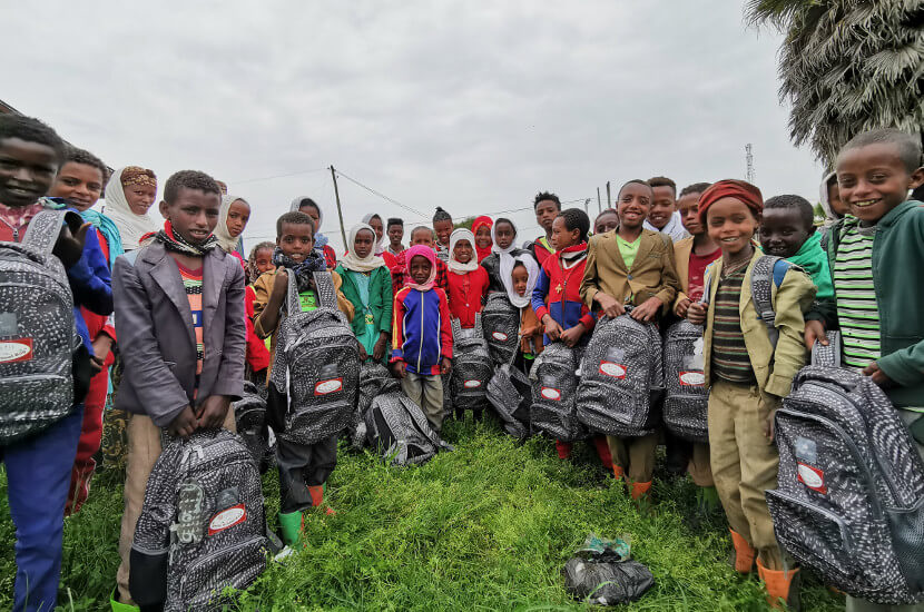 Local students in schools at Addis Abeda showing their new schoolbags provided by Amity