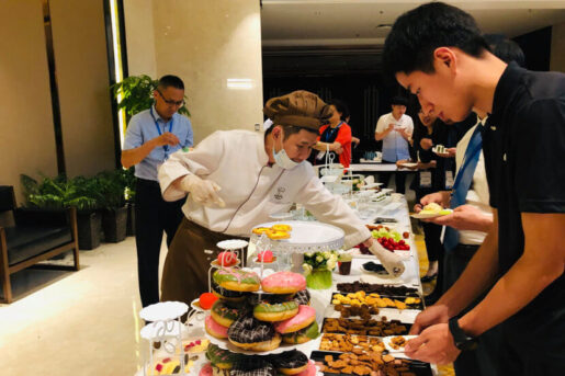 Amity Bakery staff is organizing a tea buffet during a company event