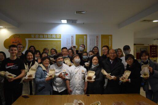 Overseas volunteers baking cookies with Amity Bakery staff