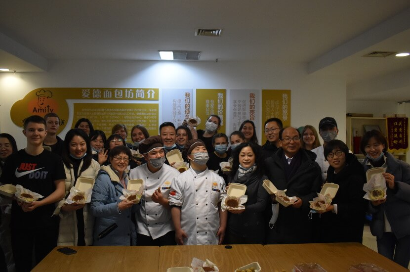 Overseas volunteers baking cookies with Amity Bakery staff