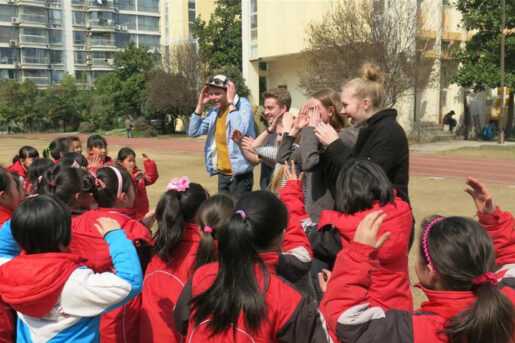 Overseas volunteers interacting with students in Amity's social service learning program