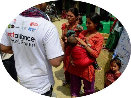 ACT Alliance staff talking with locals during a disaster relief project in Nepal
