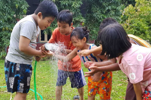 Children in Myanmar enjoying the fresh water provided by Amity's newly built Living Water facilities