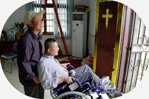 Father with disabled son happily testing their new wheelchair