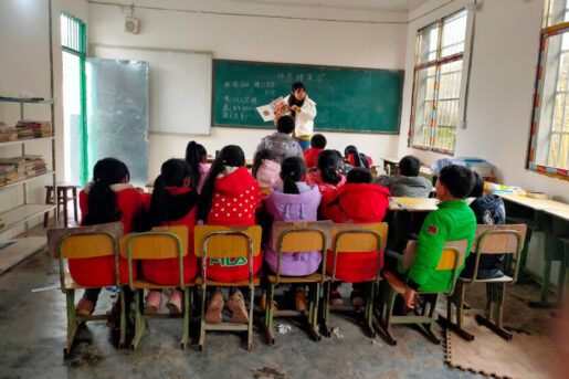 Students in a school room participating in the Amity book club