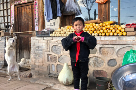 Sponsored by forming a heart with his hands in front of his rural home