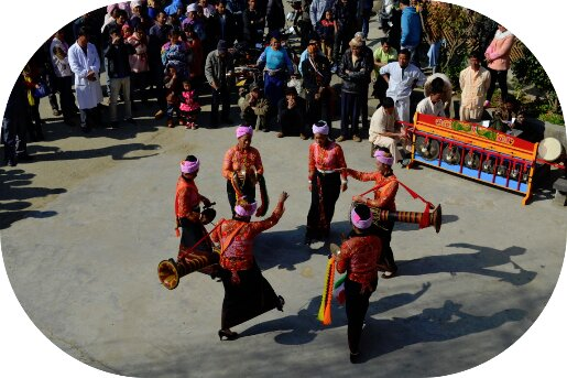 Photo of dancing and performing women of a women's association in traditional clothing in Amity's community development program in Yunnan Province