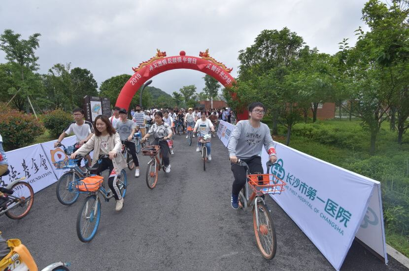 People riding bicycle during a AIDS/HIV awareness event
