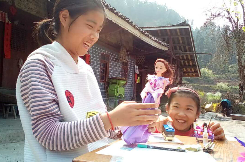 Children from rural areas playing with new toys