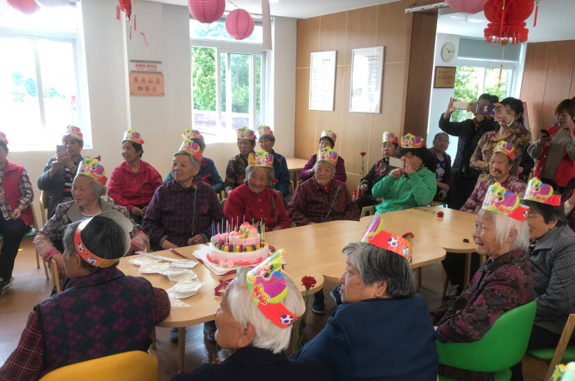 Elderly at Amity's elderly home celebrating a birthday party