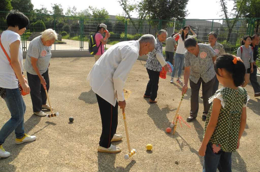Elderly playing outdoor sports at Amity's elderly home