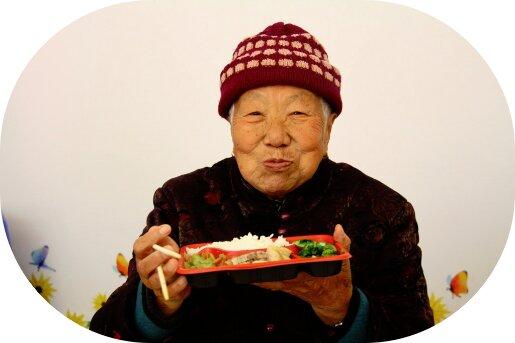 Happy elderly women receiving free meal