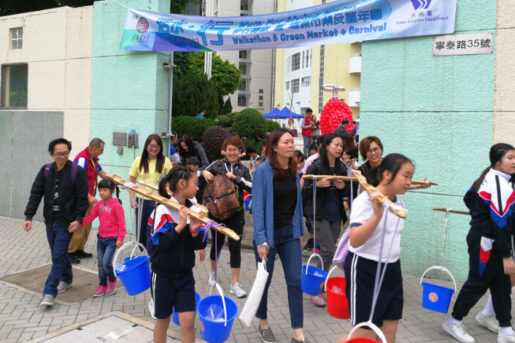 Participants of the Walk for Living Water carrying buckets with water