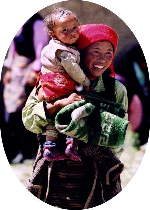 Ethnic minority women carrying her child on the arm