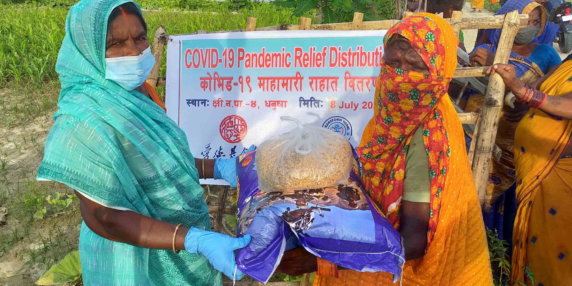 Nepalese women receive rice and food support during the Covid-19 pandemic