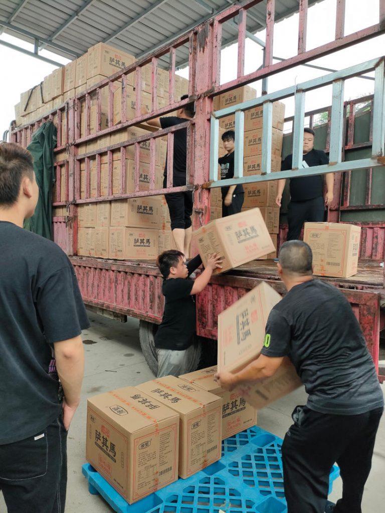 Amity supplies loaded on trucks