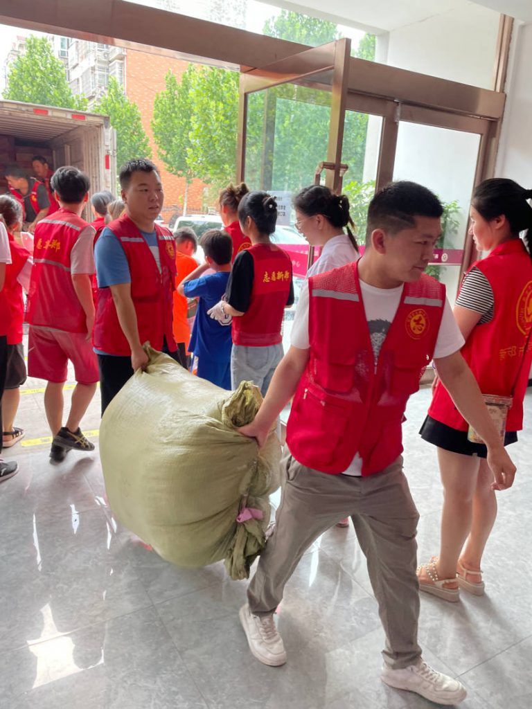 Local partners unloading Amity supplies in the city of Xinyang