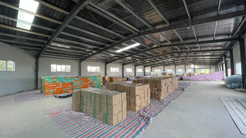 relief supplies supported by Amity are stored in a hall