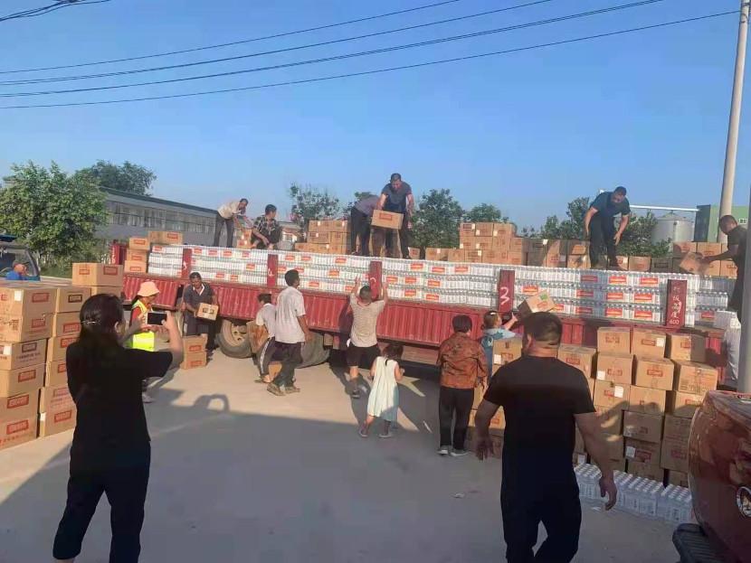 Volunteers unloading truck with relief supplies