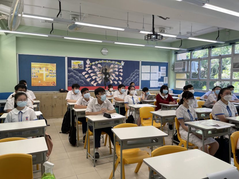 students in the classroom listening to the international guest speaker online
