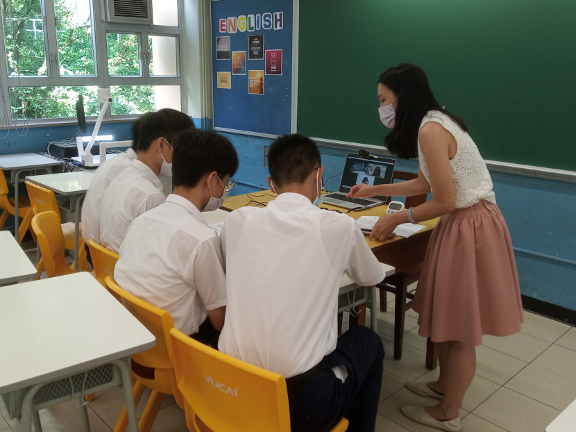 students discussing in the classroom with each other