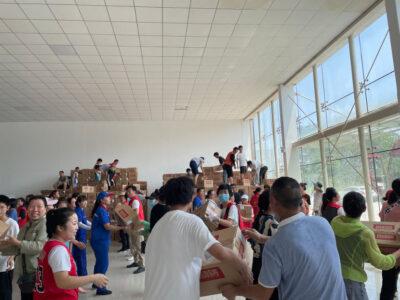 Volunteers carrying relief supplies in logistic depots