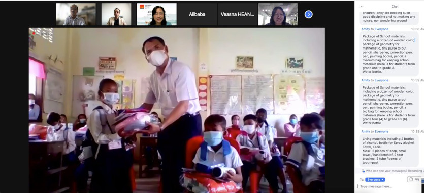 Zoom meeting showing the distibution of materials inside a class room in Cambodia